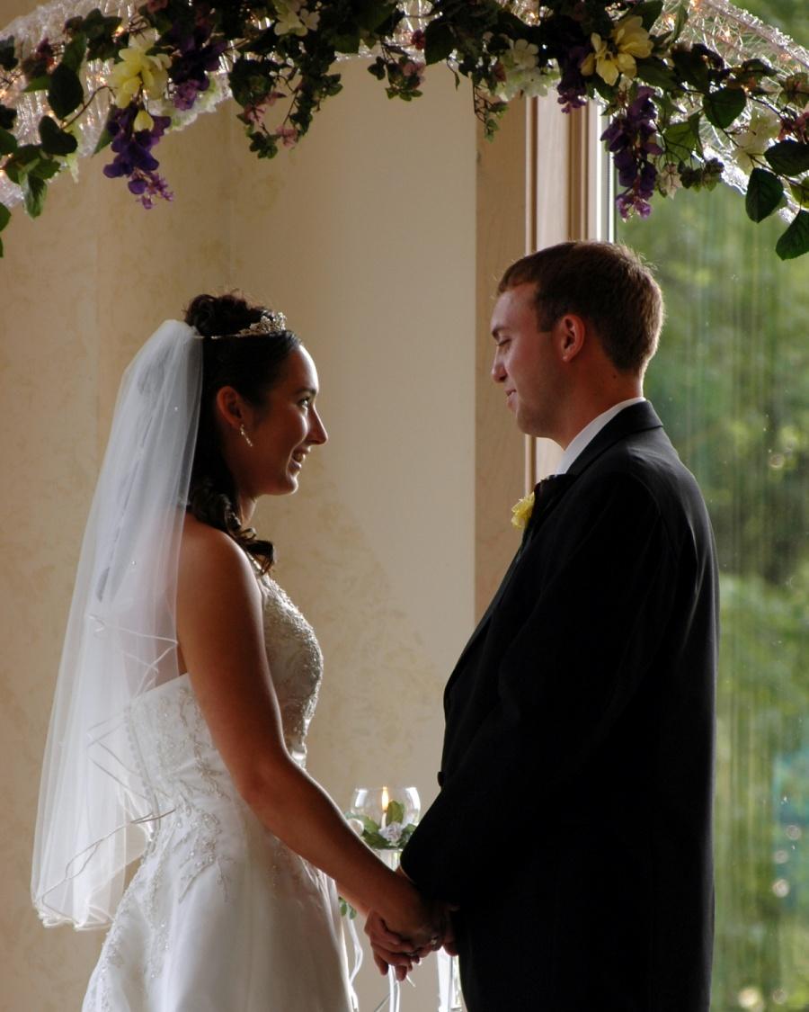 8x10-bride-and-groom-ceremony-facing-e1469046885332