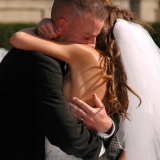 8x10 bride and groom ceremony hug