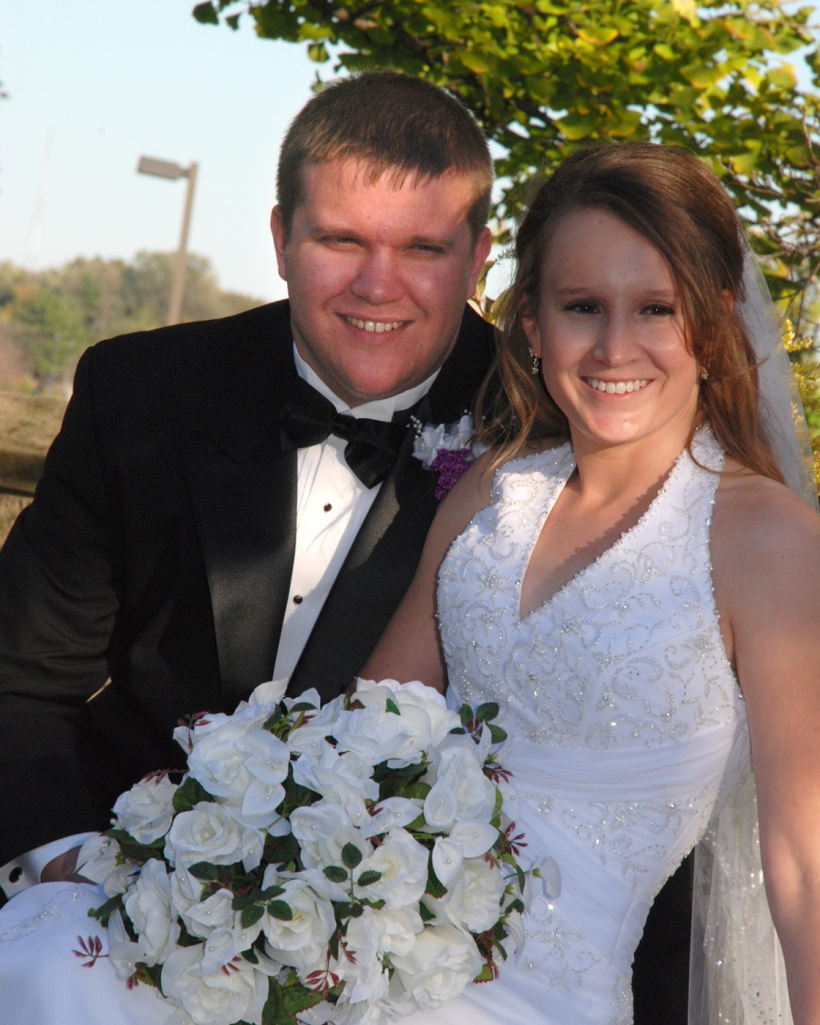8x10-bride-and-groom-sitting-sideways-e1469046794657