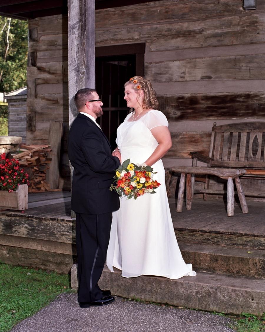 8x10-cabin-porch-bride-and-groom-e1469046660377