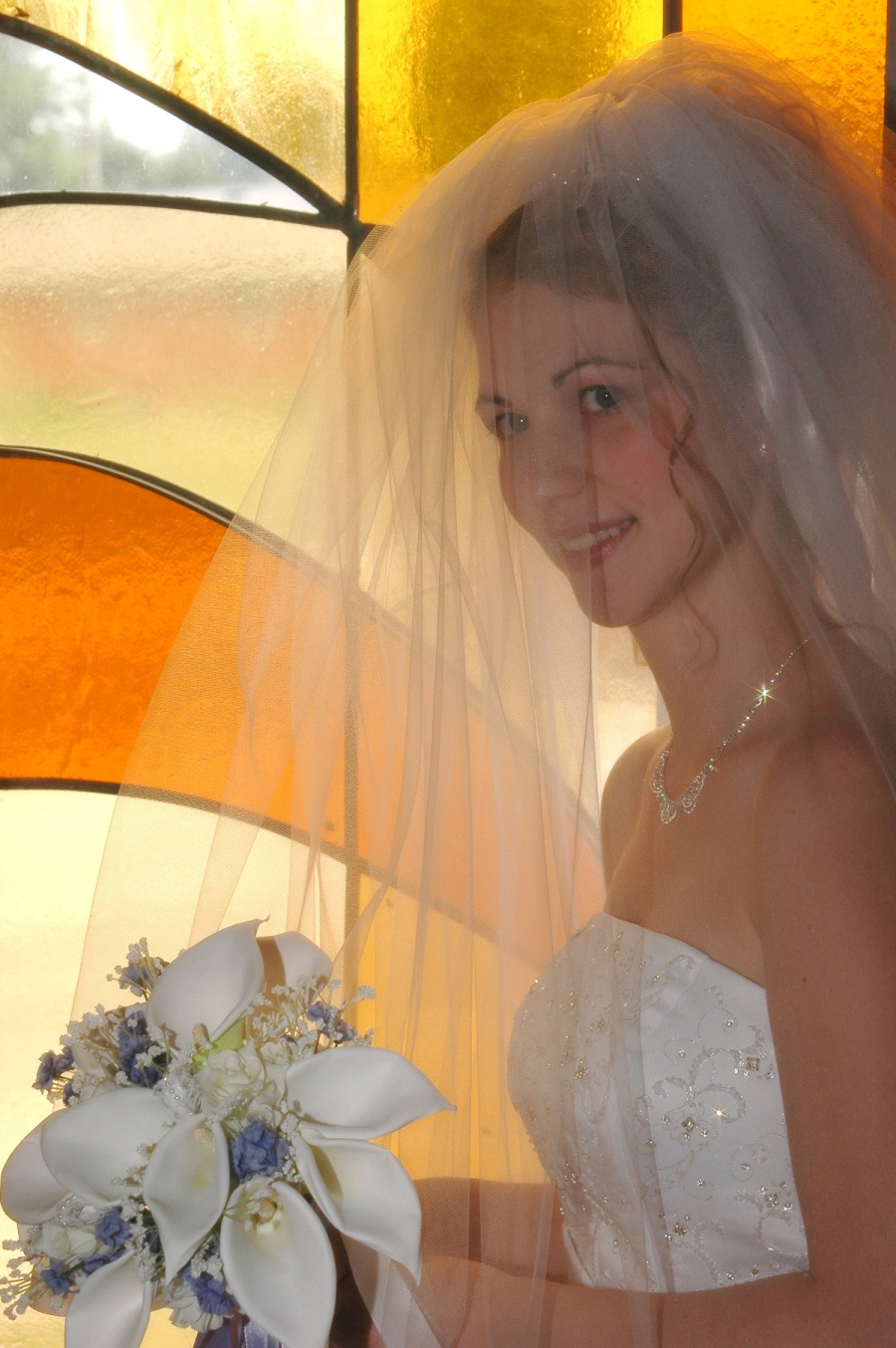 8x10-ish-bride-with-bouquet-stained-glass-e1469046541965